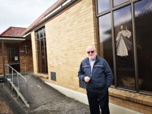 Father Leonard Danvers outside St Peter's Catholic Church in Cambridge.
